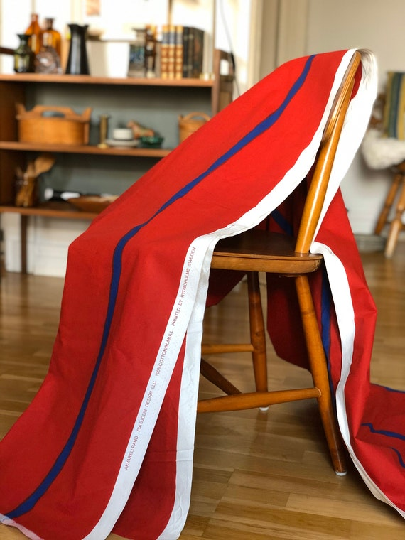 large fabric bolt designed by Pia Sjön for Rydboholms Sweden called Akvararellrand / water color stripe red and blue material