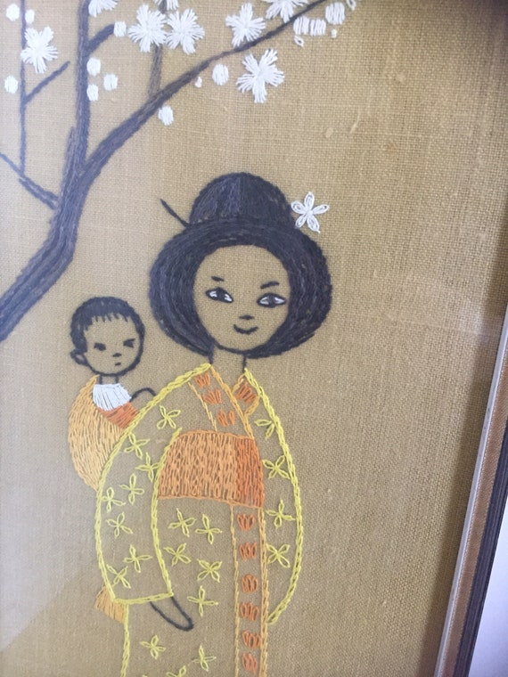 Japanese/ wall hanging/embroidered/ mother and child/ orange gold yellow white browns/earth tones linen/framed/glass /chinoiserie