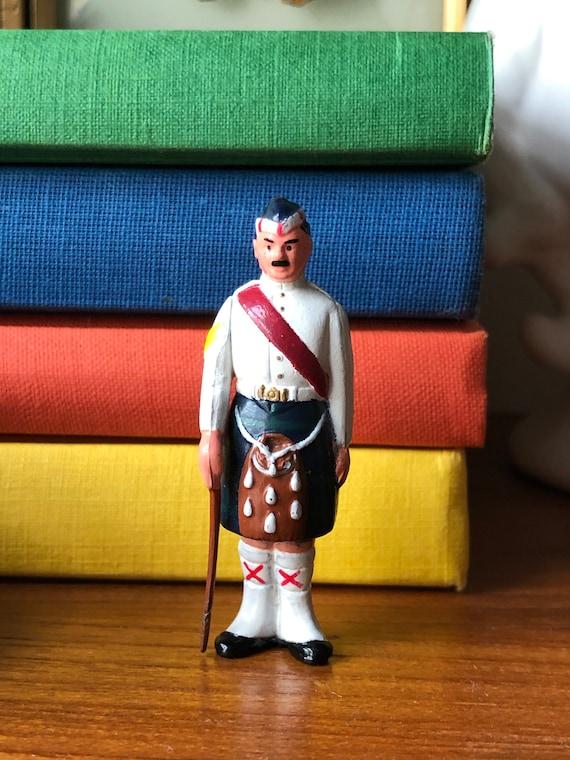 Vintage Scottish miniature man in kilt solid metal hand painted