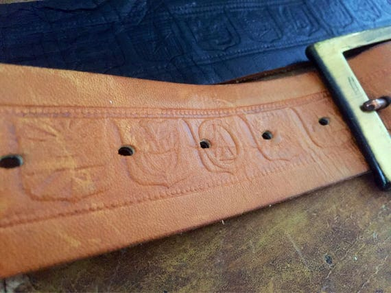 Tooled leather belt brass buckle with patina leather laced detail jacob great 70s vibe folk