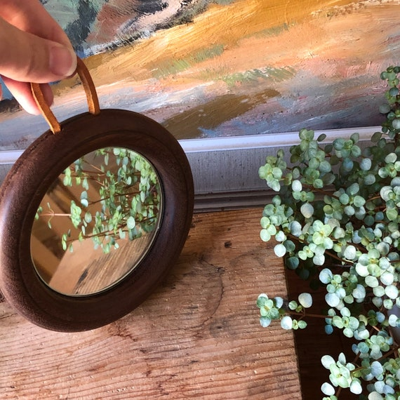 Small Scandinavian teak round wooden mirror with leather strap  mid-century modern