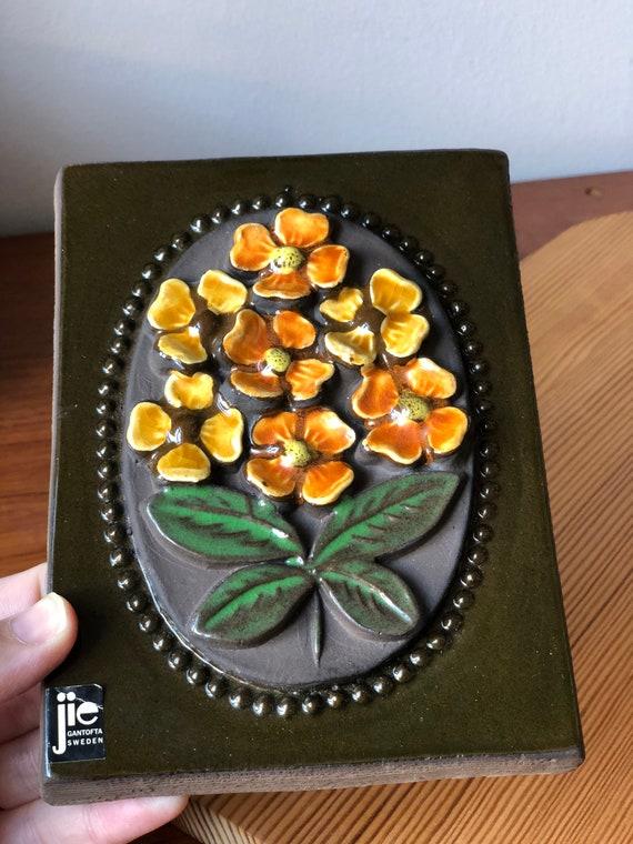 Orange flowers Jie Gantofta Sweden ceramic wall tile / wall plaque ceramic tile from the Blekinge series featuring series 844