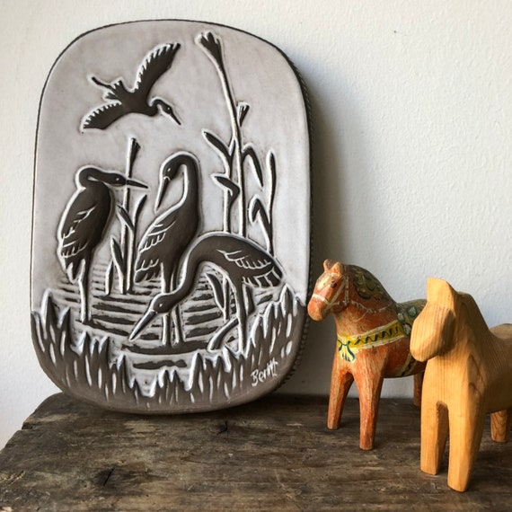 1950s/ ceramic plaque from the Swedish potter Norrman Motala featuring cranes birds wall hanging