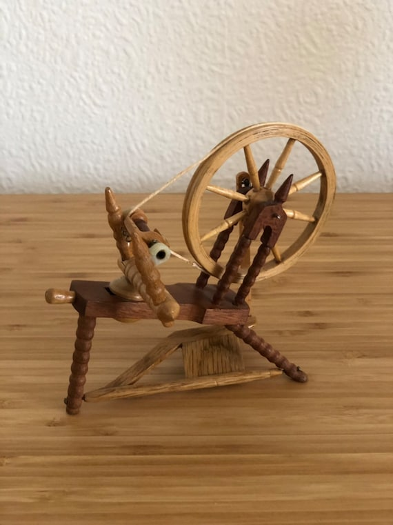 Miniature hand carved wooden  spinning wheel with working wheel and pedal