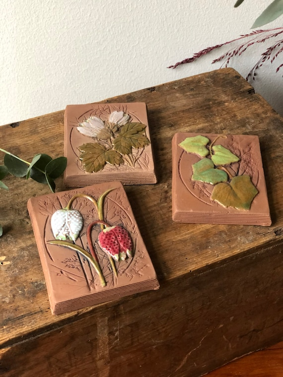 Set of 3 Jie Gantofta Sweden ceramic wall tiles / wall plaques featuring the provincial flowers from Swedish provinces