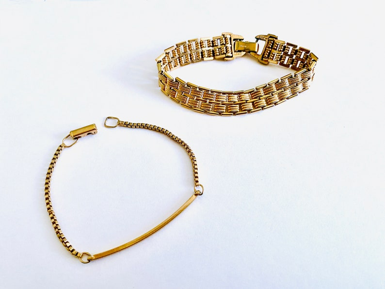 Two 6.5 Stacking Bracelets Vintage Avon Gold Tone Casual Bracelets Narrow Box Chain with Center Long Curved Link and Wider Link Bracelet