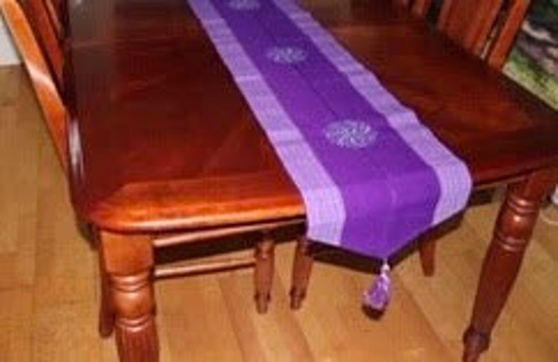 Luxurious table runner with handwoven tassels fit for royalty