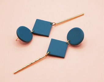 Long duck blue earrings with stainless steel gold charm, modern polymer paste jewelry