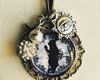 Chain with a pendant of Alice in Wonderland