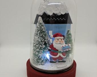 Santa House Cloche on Wood Base Christmas Tabletop Arrangement