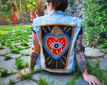 Sleeveless denim jacket with sacred heart painted and embroidered by hand