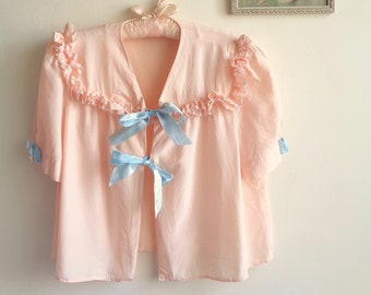 Vintage 1940s Peach Pink Silk Crepe Satin Bed Jacket with Ruffled Yoke, Light Blue Ribbon Bow Accents