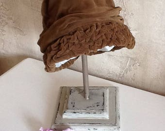 wearing old hat made of linen and Golden taupe aged and weathered painted wood