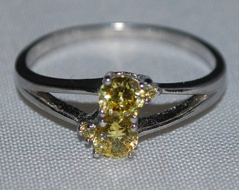 Sterling Silver ring size 7 with yellow citrine setting.