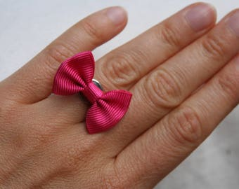 Pink Adjustable ring with a bow tie