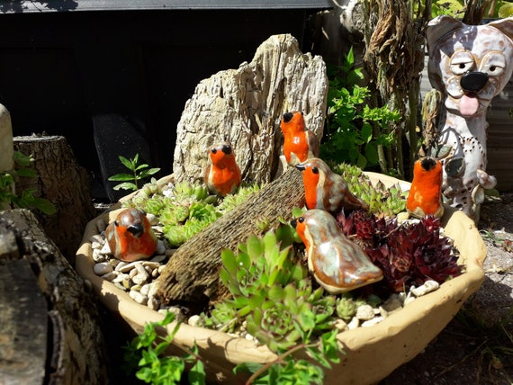 Six Miniature Pottery Robins