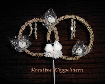 Wedding decoration plug in ring form with bobbin work