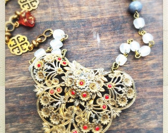 Simply gorgeous long beaded chain with vintage pendant ruby dress pin and brooch embellishments.