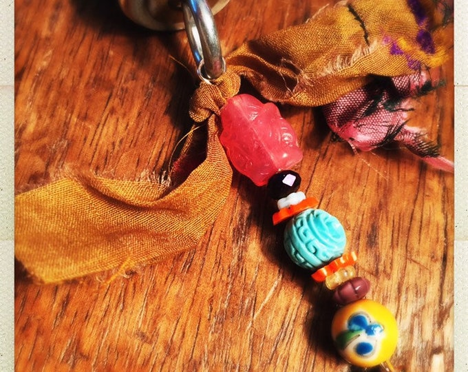 Featured listing image: Happy Buddha Narmada Winery wine cork keychain - cloisonné bead and fair trade sari ribbon