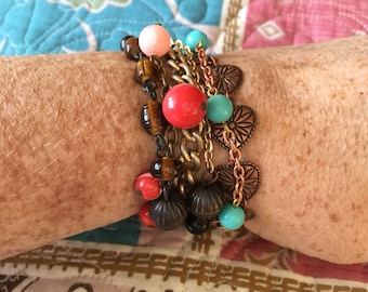 Wonderful bronze & copper colored wrap bracelet made with vintage and newer jewelry. Can also be worn as a long necklace!
