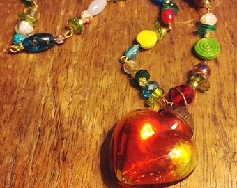 Glass puffed heart. Such a happy piece - vintage glass beads are strung on copper eye pins. Lovely!
