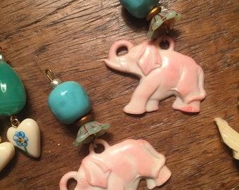Cracker Jack prize white plastic elephant dangle earrings