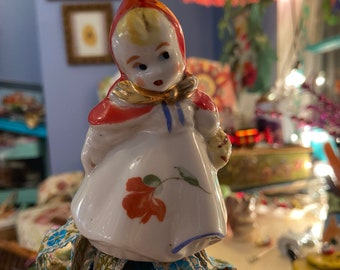 Sweet vintage girl ornament adorned with ribbons to decorate your home