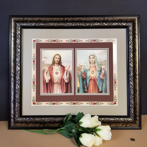 Sacred Heart of Jesus and Mary prints beautifully framed picture with decorative floral border framed in gold and black frame