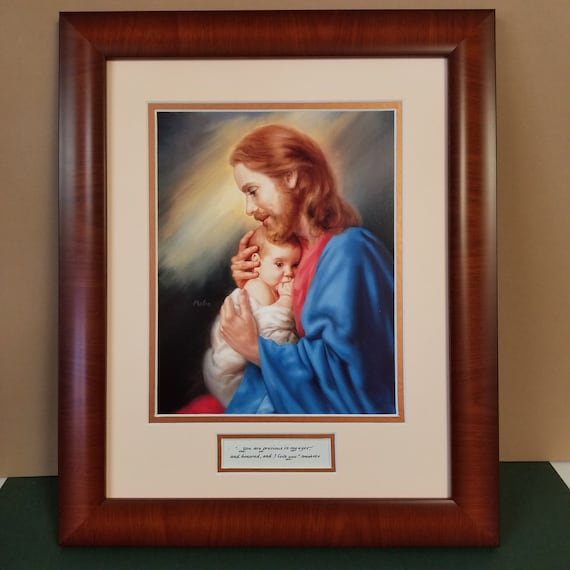 Jesus lovingly holding infant baby in lap beautifully framed and matted print with Isaiah 43 You are precious in my eyes verse