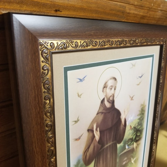 """Saint Francis Art framed and matted with birds and halo measures 12"""" X 14"""""""