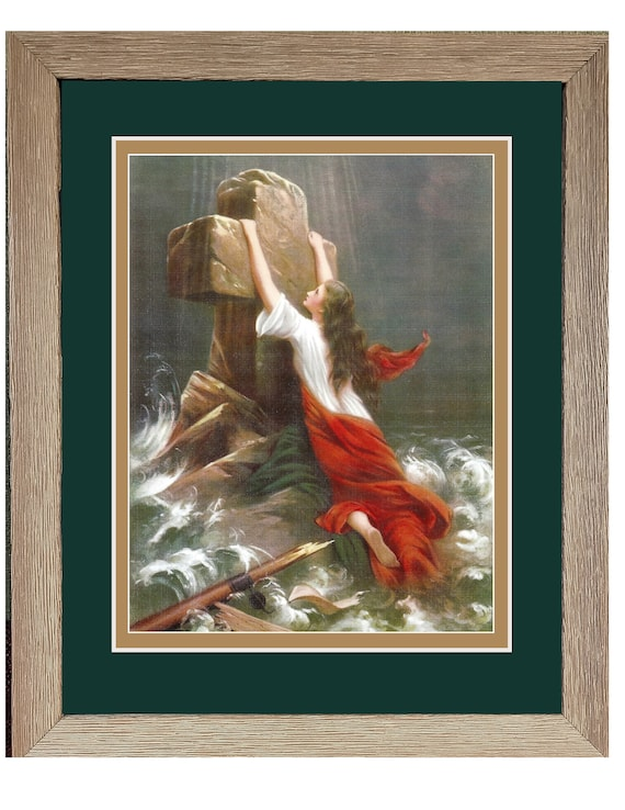 Cling to the cross woman clinging to cross in the sea framed picture