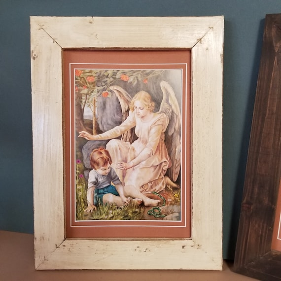Guardian Angel with child playing in the grass print matted and framed in rustic farmhouse style frame