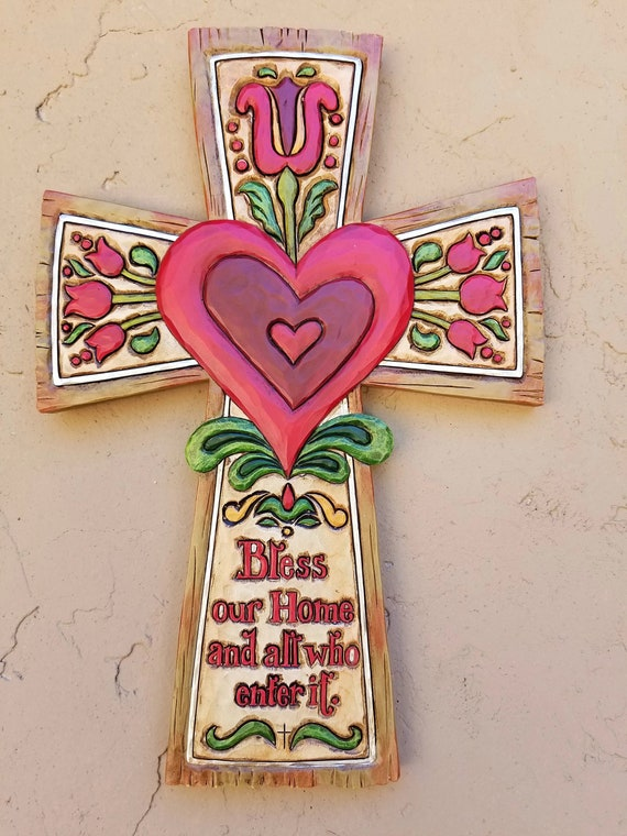 Jim Shore Bless our Home Wall Cross with red heart in the middle for home, friendship and holidays. A heart-warming message.