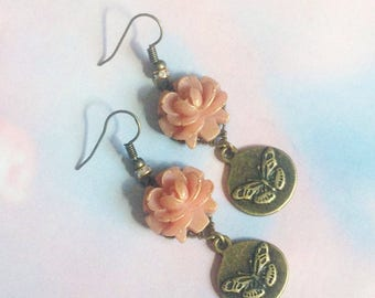 Pair of pink earrings painted by hand and Butterfly Medal