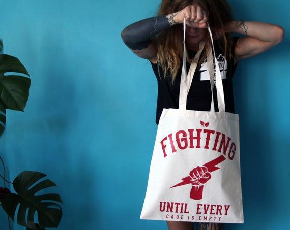 Fighting Until Every Cage Is Empty TOTE BAG