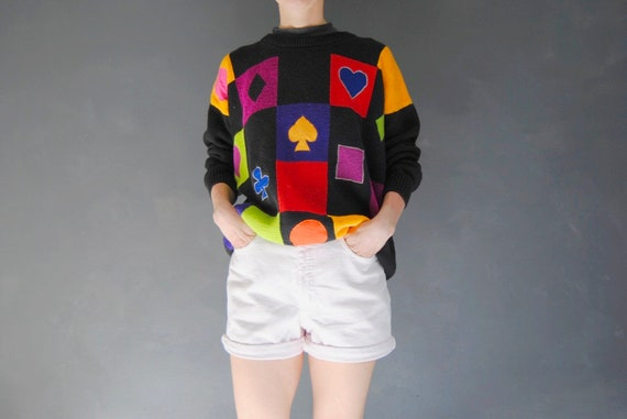90s checkered sweater with geometric shapes -- vin