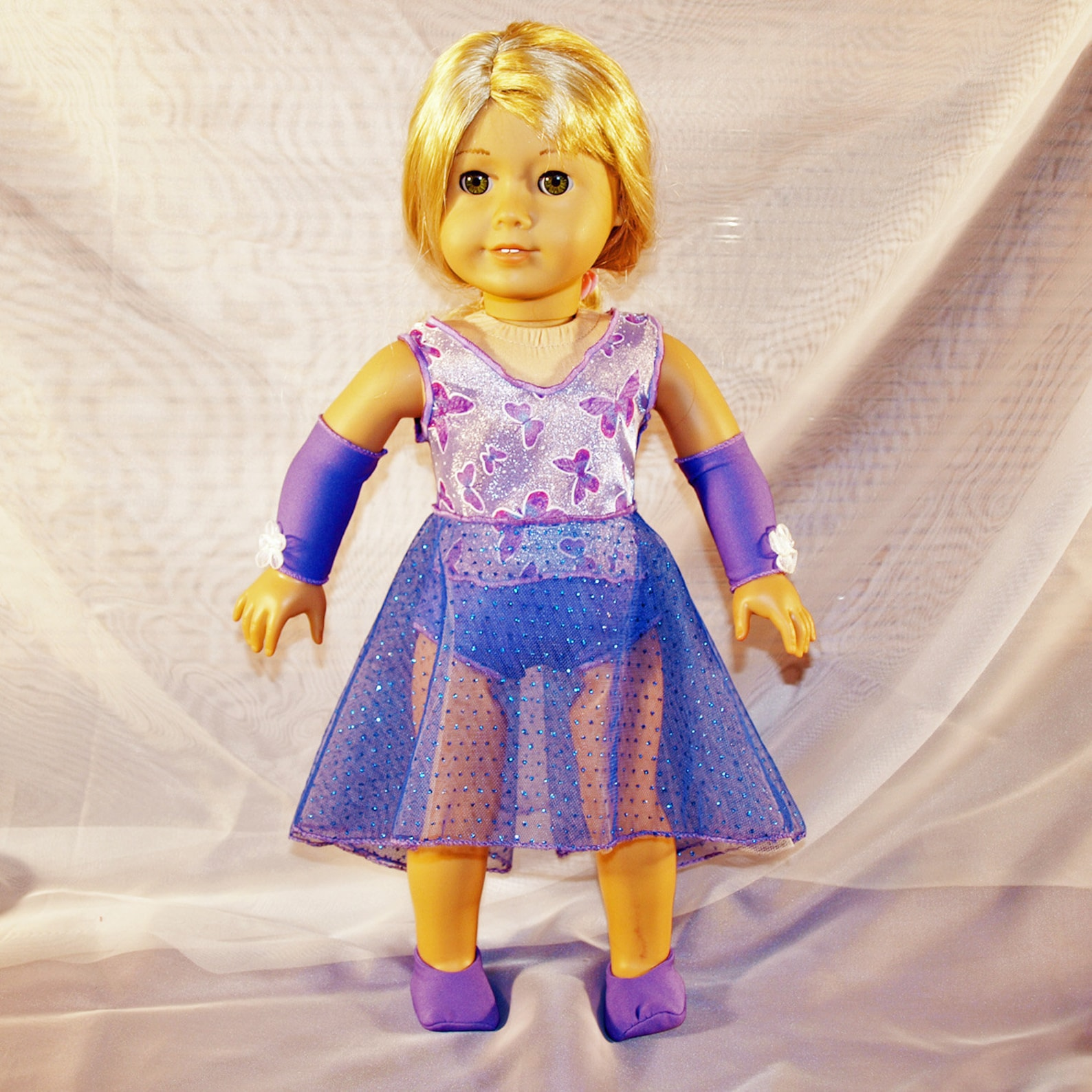 dance costume for ballet or lyrical in shades of purple with hair clip, armbands and shoes, modeled on american girl doll