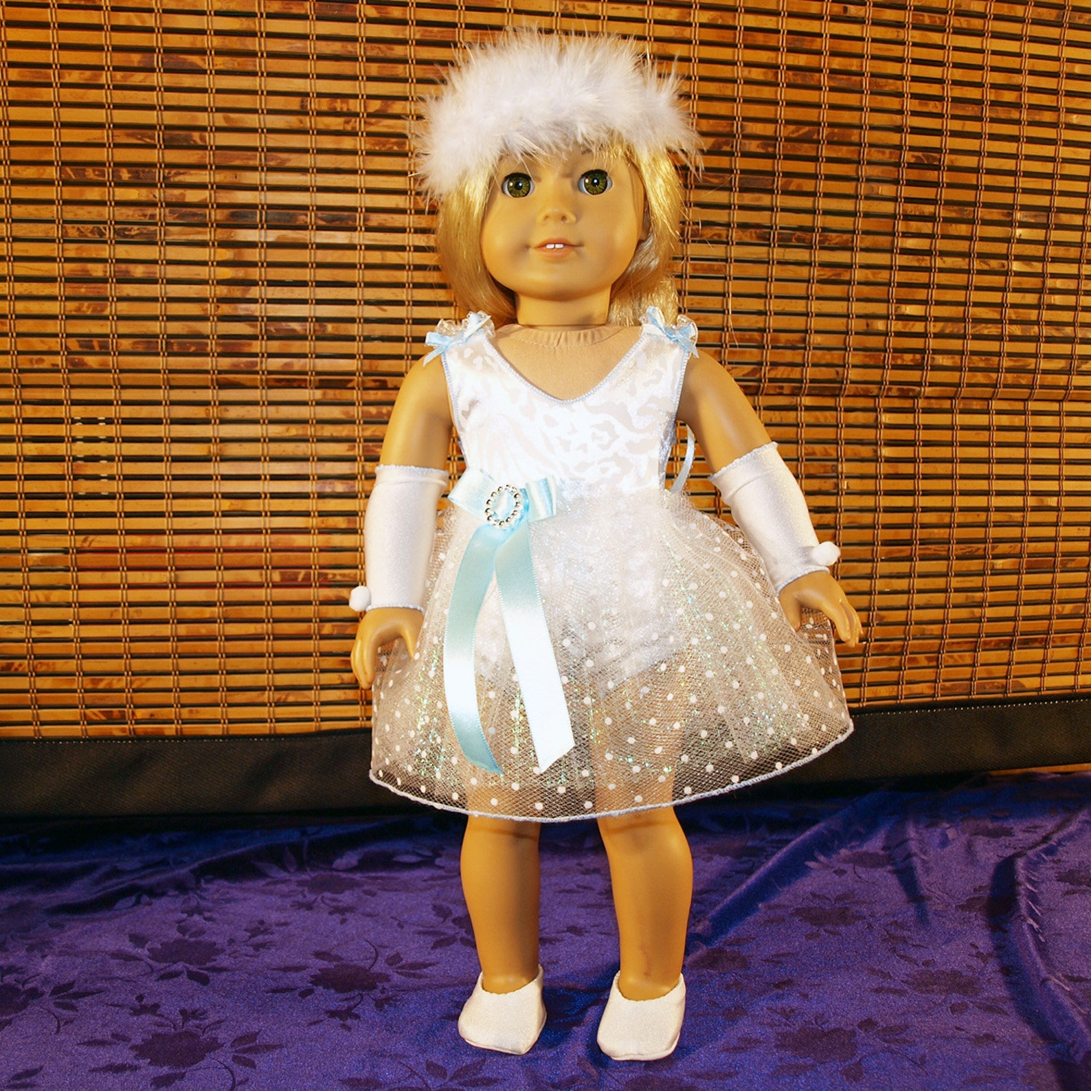 dance costume for ballet or lyrical in white, with blue bow and feather headband and shoes, modeled on american girl doll