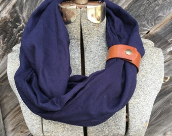 Navy eternity scarf with a brown leather cuff