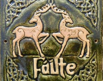 Celtic deer ceramic 'welcome 'wall plaque in moss green