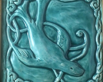 Handmade Celtic Seal ( Selkie) ceramic bas relief tile in Turquoise  glaze