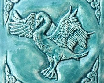 Handmade Celtic swan Ceramic bas relief tile in turquoise glaze