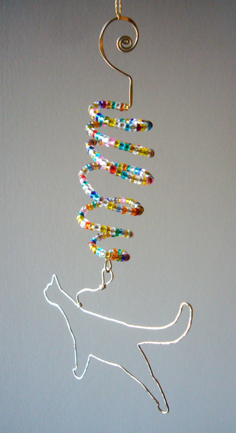 Brass Cat Ornament with Twist.. Hammered brass wire cat ornament with a multi-color seed bead twist