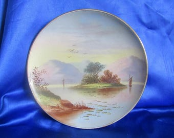 Vintage Nippon Plate with a Hand Painted Island scene of 2 Boats, Mountains and Lily Pads, Decorative Wall-hanging
