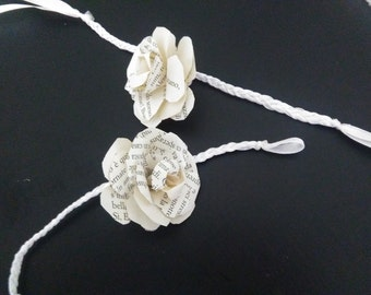 Bride or bridesmaid with paper rose and satin tape
