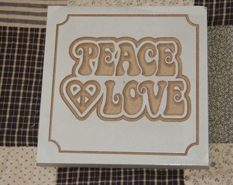 Small carved wooden signs
