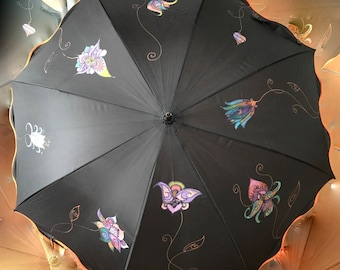 Black umbrella from Orange wave borders with application of hand painted silk flowers and golden stems