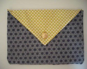 Pochette motifs géométriques noirs et jaunes