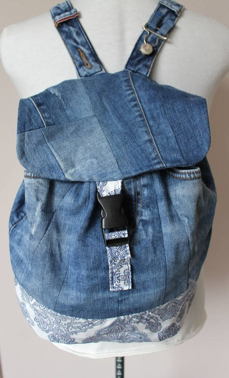 Handmade upcycled one of a kind denim backpack with beautiful barok lining