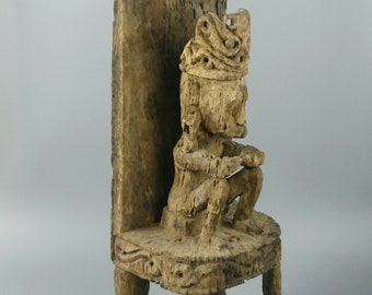 Great Timorese idol on his heavily weathered wooden throne - Indonesia